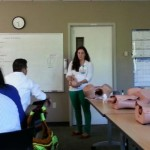 Dr. Parker using mannequins to demonstrate technique in Mini ALSO workshop