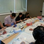 Interns learning various obstetric suturing skills