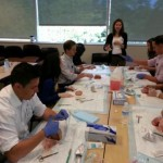 Faculty instructor, Dr. Rudisill, explaining suturing to new interns