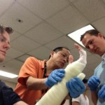 Dr. Woo teaching residents Drs. Jones and Lawson in casting workshop