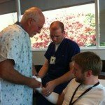 Drs. Kelsberg and Powers fine tuning the cast on Dr. Ashbaugh