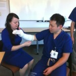Dr. DeLucia practicing her casting skills on Dr. Lee