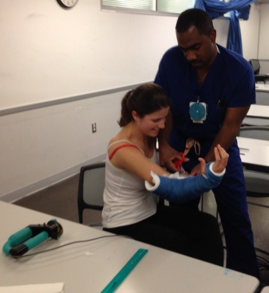 Using scissors to remove cast from UW medical student - Dr. Russell