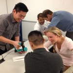 Dr. Shum working with UW medical students