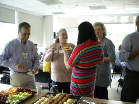 VFM Staff, Residents, Faculty chatting over breakfast